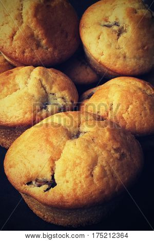 Dark muffins on the photo. Homehade sweet snack.