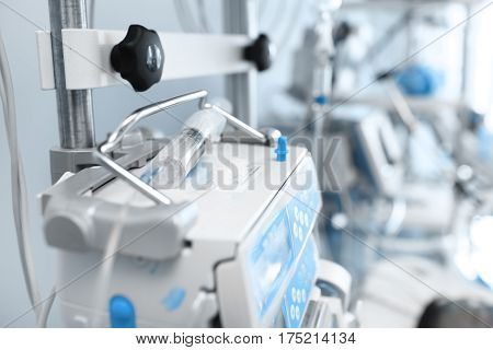 Syringe on the medical equipment in ICU.