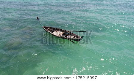 Aerial view of boat on the sea and fisherman in the water hunting