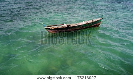 Aerial view of fisherman boat floating on the sea