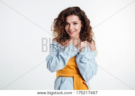 Charming young pretty woman posing isolated on the white background