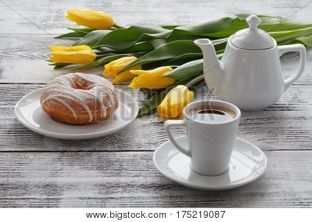 Breakfast With Donut And Yellow Flowers On Table