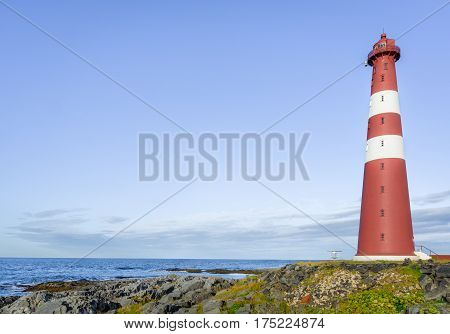 Close up of red lighthouse at Slettnes near Gamvik in Finnmark, Northern Norway