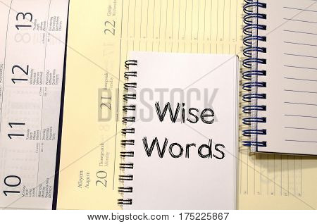 Wise words text concept write on notebook