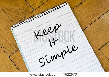 Keep it simple text concept write on notebook