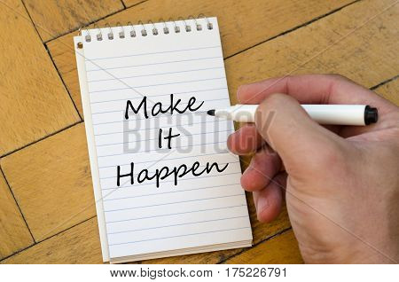 Make it happen text concept write on notebook