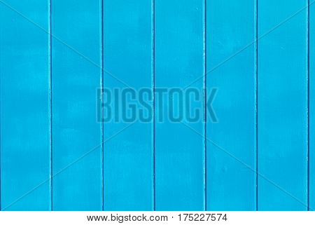 Light blue painted wooden wall useful as background