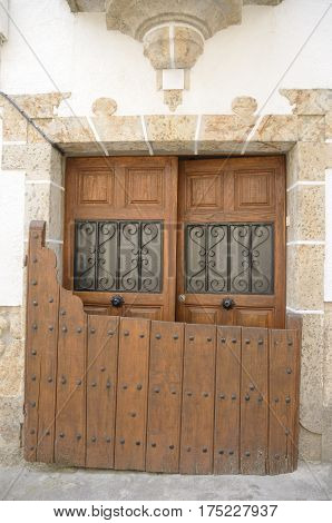 Traditional half door on the outside of the lintel of the entrance gate to the house in Candelario Salamanca Spain.