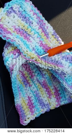 Pastel crocheted wash wrag with crochet hook
