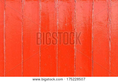 Red painted wooden wall useful as background