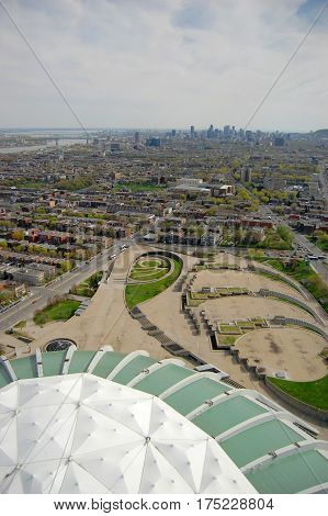 Montreal Olympic Park and city skyline, Montreal, Quebec, Canada. Montreal Olympic Park is the site of the 1976 Summer Olympic Games.