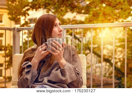 carefree woman in new home apartement relaxing on terrace