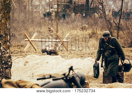 Gomel, Belarus - November 26, 2017: The Soviet officer shoots at the retreating German soldier. Reconstruction