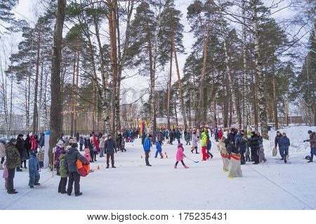 Kostroma, Russia February 16, 2017: Kids celebrate Maslenitsa Pancake week - purely Russian Holiday. People eat pancakes, play folk games, have fun letting long winter out, Moscow, February 16, 2016.
