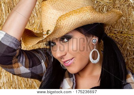 Beautiful smiling woman wearing cowgirl hat