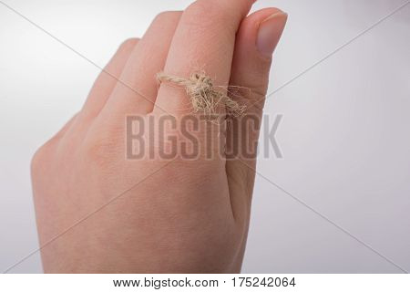 Thread Knot In Hand On A Light Color Background