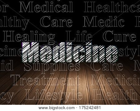 Medicine concept: Glowing text Medicine in grunge dark room with Wooden Floor, black background with  Tag Cloud