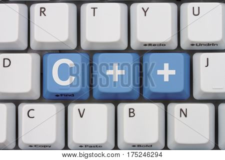 Computer coding with C++ A close-up of a keyboard with blue highlighted text C++, 3D Illustration
