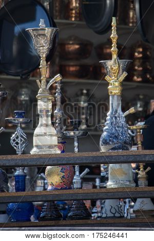 Group Of Eastern Hookahs Of Various Colors On A Shelf