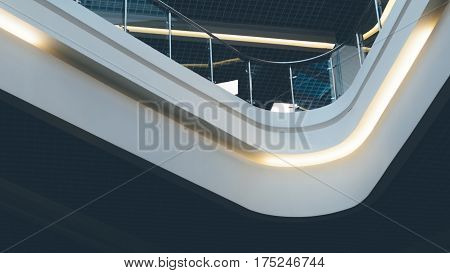 Contemporary spaces of public place. Mezzanine with glass balcony railing. Ceiling lighting in a modern building. Griliato ceiling