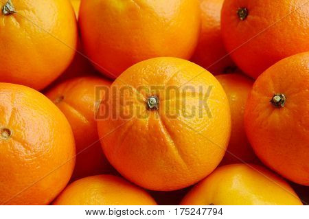 A lot of An orange, whole and split in sack bag.