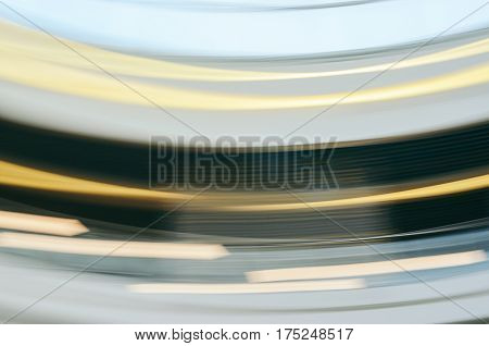 Colorful horizontal motion blur texture for background. Abstract light effects of public interior by low speed shutter and long exposure shot.