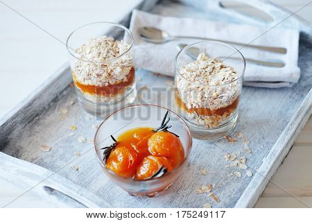 Oats layered with spicy and sweet apricot jam served for breakfast. Healthy food concept.