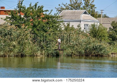 House By The River. Fishing Near The House By The River, Overgrown With Reeds