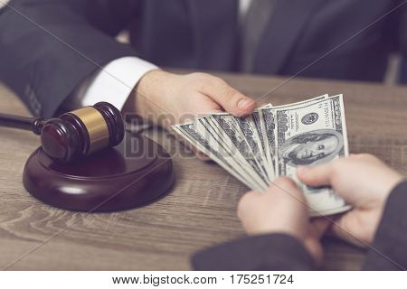 Detail of a corrupted judge taking a bribe money. Selective focus