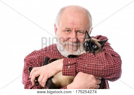 Headshot of cheerful and calm handsome bald and bearded senior man with siamese cat, isolated on white background