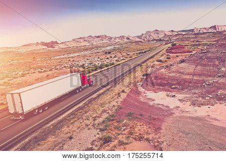 Truck Transport Concept. Semi Truck on the American Desert Highway.