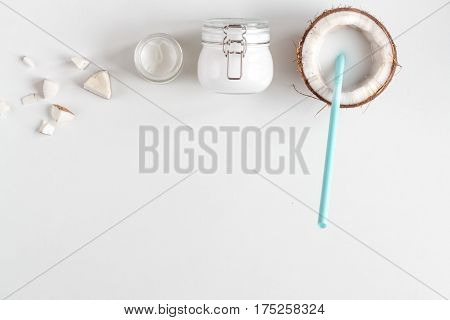 organic cosmetics with coconut on white background top view mockup.