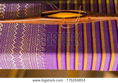 Beautiful traditional fabric Thai design, Purple and gold thread, sensitive Focus