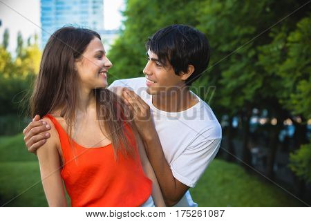portrait of happy Hispanic couple in the park
