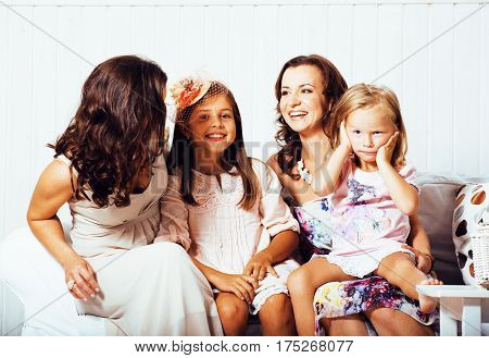 Mature sisters twins at home with little daughter, happy family smiling close up, lifestyle modern real normal people concept cheerful