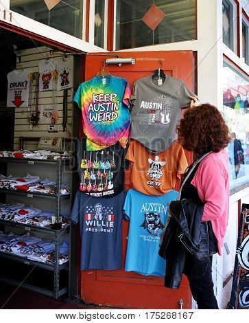 AUSTIN, TEXAS - MAR 8, 2017: SXSW  South by Southwest  Annual music, film, and interactive conference and festival in Austin, Texas.  Tourist buying t-shorts with Austin symbolic