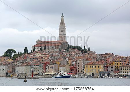 Church Tower and Colorful Houses at Seafront in Rovinj Croatia