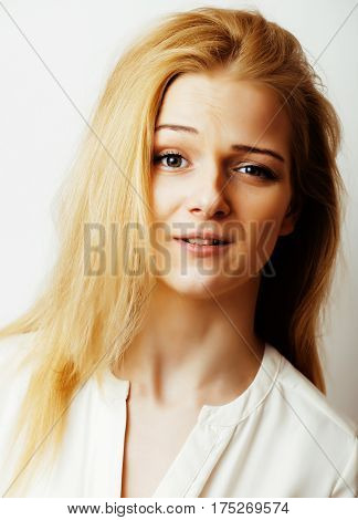 young blond woman on white backgroung smiling gesture thumbs up, isolated emotional posing close up, lifestyle people concept