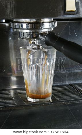 Double latte being extracted from a professional espresso machine.