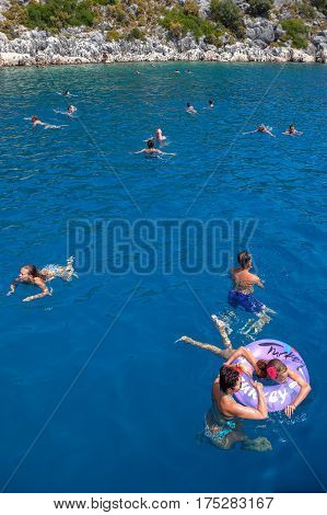 Antalya Turkey - 28 august 2014: Passengers of a pleasure yacht bathe in the waters of the Mediterranean Sea during the excursion.