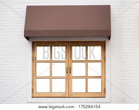 Cafe outside with white wall wooden window and brown awning