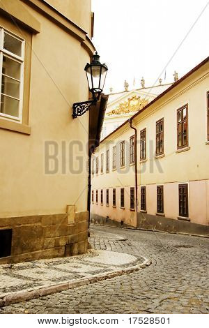 A small skinny street detail in the old town area of Prague, Czech Republic.