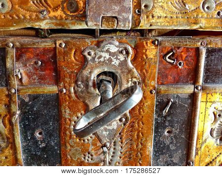 Lock and key. Closeup. Iron-bound coffer from the last century. Old iron-bound coffer grandmother's. In such was stored dowry. Retro.