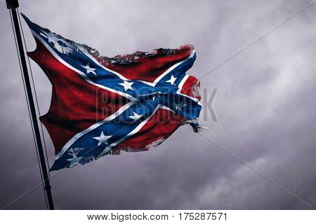ripped tear grunge old closeup of waving confederate flag of the national states of america us fabric texture american symbol sign on cloudy sky dark mystery style atmosphere