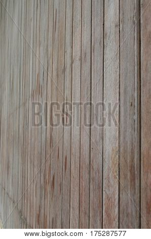 Side view of brown wood slat wall fasten with nail for background and texture