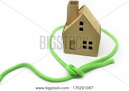 Paper House Surrounded By Green Rope