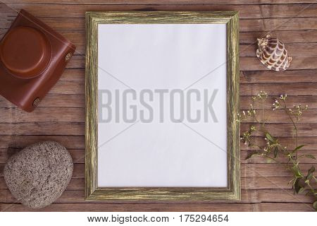 White page in vertical wooden frame photo background. Rustic wooden board backdrop with natural decor. Retro style flat lay with sea pebble and shell. Shabby chic banner template with place for text
