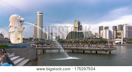16 January 2017: Singapore's famous landmark - the Merlion statue. Central business district skyscrapers in the background