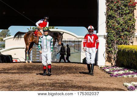 DEL MAR, CALIFORNIA - NOVEMBER 25, 2016:  Two jockeys heading to the paddock area at the Del Mar racetrack.
