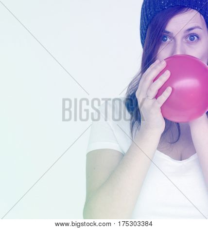 Woman blow the balloon for prepare the party